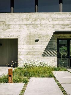 Concrete pavers and native grasses outside California home