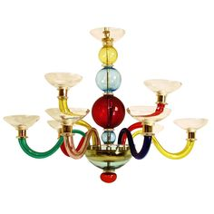 Italy  1970's-1980's  Originally designed by Gio Ponti in the 1940's, an Italian multicolored blown glass light fixture with 8 arms. Made by Venini.