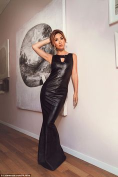 Leather luxe: Myleene Klass posed seductively in the racy tight leather dress from her new autumn/winter collection