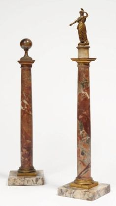 ATTRIBUTED to GIOVANI & GUISEPPE VALADIER - 2 Red Breccia Marble and Gilt Bronze Columns. One is decorated with an agate sphere, the other is topped by a statue of Minerva. They are based on some square white marble bases. Italy, late eighteenth century. Dim. One H: 35 cm The other H: 42.5 cm.