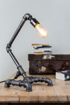 UK Handmade Steampunk style Iron Pipe Lamp from Stubwick. This is a handmade Industrial style Lamp made from malleable iron pipe and includes a free