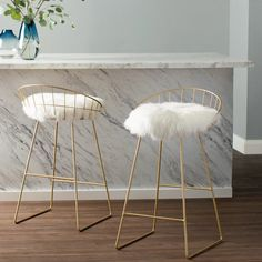 Gold counter stool with removable sheepskin pad and gray linen removable cushion underneath. Look for Kylie Sheepskin Chair for a coordinated look in your living space.