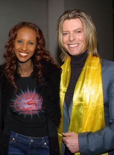 2001-In a bright yellow scarf, Bowie+Iman backstage during the Tibet House Benefit Concert at Carniege Hall