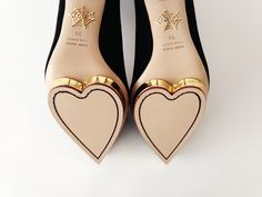 A modern classic, Charlotte Olympia's black Debbie pumps make the ultimate Christmas gift