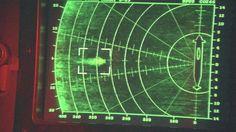 Sonar screen tracks a missile targeting a submarine