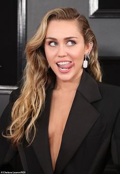 Miley Cyrus dons sexy black ensemble on red carpet at 2019 Grammys The Franklin, Tennessee native had her long blonde locks down with waves on the side, accessorizing with silver earrings and rounding out her ensemble with black and gold sandal heels. Celebrity Couples, Celebrity Photos, Celebrity Style, Celebrity Women, Rihanna, Miley Cyrus News, Miley Cyrus Grammys, Miley Cyrus Hair, Miley Cyrus Style