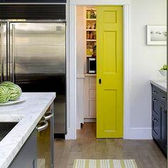 Monochrome + bright yellow door