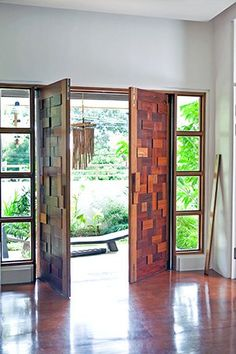 The double doors are made from different pieces of reclaimed wood. The doors can be locked with a plank (seen below right) slipped into two wooden slots on the doors.