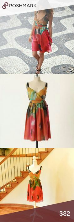 """Anthropologie*  Blurred Boundaries *  dress The highly desired, sell out """"blurred boundaries"""" dress of Anthropologie circa spring 2010. ?""""A rainbow of muted floras on chiffon. A liquid-like surplice flows into a rippling A-line skirt, showcasing the spectrum of hues that ebb and flow across its silk surfaces. By Tabitha.?100% Silk Shell,?Acetate lining.?Dry Clean.?38.5""""L.?Imported."""" Watercolor look. Size 4 fits small. 13"""" waist. 16"""" bust. Anthropologie  Dresses Midi"""