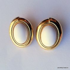 Vintage Monet Clip On Oval Button Earrings in White and Gold Tone Metal from JamieRayCreations, $9.50 https://www.etsy.com/listing/182827248