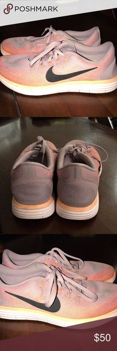Nike Free Run Distance 2 Great condition! Worn a few times, but a couple of stains on toe area.  They are mainly a lavender color with coral and orange accents and a white bottom. Nike Shoes Athletic Shoes