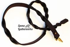 Simple and stunning, walk your pup in style with this Epona lead/leash.  53 inches long on brown harness leather, two signature braids and brass clasp $50.00