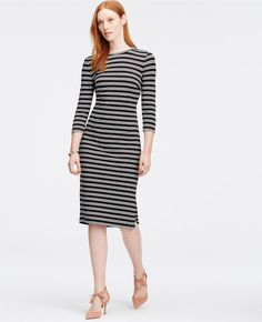 "Lead fashion's front lines in this smartly striped dress, sporting slim bands of contrast color for undeniably sharp style. Jewel neck. 3/4 sleeves. Exposed back zipper. Side slits. 26"" from natural waist."