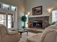 Living room with cozy leather sofas and beautiful gas fireplace.