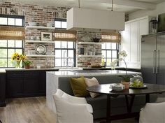Kitchen with brick wall and banquette