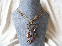 Dreamcatcher, tribal necklace. Various beads, string, green jade, feather, murble, bronzite and  vulcanic rock.
