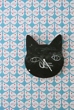 Easy enough DIY: cool shape (foam core), chalk paint, clock kit (children's wallpaper and clock via Little Helsinki)