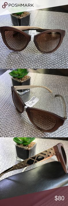 Stylish Burberry Sunglasses Authentic Burberry Sunglasses, Gold metal, brown frames, New, case not included, see last pic for size description, made in Italy Burberry Accessories Sunglasses