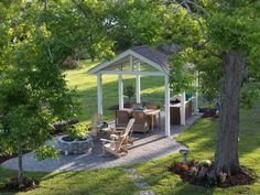 Set back from the rest of the house, this backyard pavillion offers a place to cook, dine and relax by the fire.