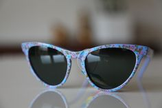 Blue Violet Cat Eye frame, decorated with Blossoms on the frame, and with Dark Green Polarizing lenses from Polaroid's Vintage Sunglasses Collection    Product ID POLAROID LOOKERS 8634D with Polarizing Lenses made in Italy