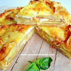 Pastel campesino con patatas jamon y queso camembert /      1 disco de masa brisa o de hojaldre.     3 patatas ( 1/2 kg).     100 gr de queso de cabra o  brie o camembert.     100 gr de jamón serrano en lonchas muy finas.     3 huevos.     100 gr de nata ( crema de leche).     100 gr de emmental o gruyère rallado.     pimienta.     hierbas provenzales, albahaca.     leche