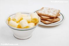 Poster of Butter curls in a bowl with crackers on white background, Food Posters, #poster, #printmeposter, #mousepad, #tshirt