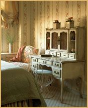 Feminine French bedroom suite.
