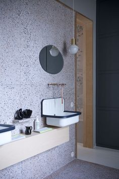 Black and white dotted terrazzo and retro lamps and fixtures look unusual together. Terrazzo inspiration for home interiors and redecoration ideas. Beautiful Bathrooms, Modern Bathroom, Small Bathroom, Bad Inspiration, Bathroom Inspiration, Bathroom Toilets, Bathroom Faucets, Washroom, Hotel Secret