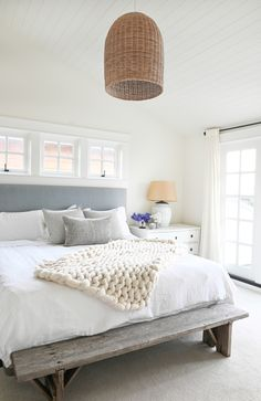 Bright bedroom with gray headboard and textured lantern. Come check out this gorgeous home tour! It's a beach house with east coast vibes. A white kitchen, black accents, and lots of texture Beach House Bedroom, Beach Bedroom Decor, Beach Room, Beach House Decor, Home Bedroom, Beach House Interiors, Costal Bedroom, Beach Cottage Bedrooms, Beach Inspired Bedroom
