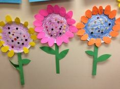 + Ideas for DIY Art Projects to Try With Your Kids craft ideas for kids, three flowers made from paper plates, colored with pencils, with stalks made from green paper and petals made from yellow, pink and orange paper Paper Plate Crafts, Paper Crafts For Kids, Paper Plates, Cardboard Crafts, Wood Crafts, Flower Crafts, Diy Flowers, Paper Flowers, Simple Flowers