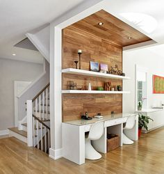 Absolutely love the timbers running up the wall and to the ceiling which not only creates the study area but also adds warmth to the interior.