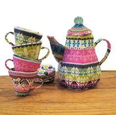 Quilted Mad Tea Party Set tutorial at Instructibles.  This tea set is made with quilting done in a dimensional way ( by hand).  It's a set of 4 teacups, 4 saucers and a teapot.