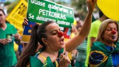 Hundreds of thousands of people have joined peaceful demonstrations across Brazil against government corruption.