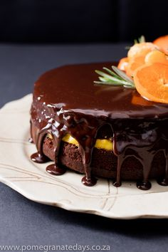 This Chocolate Clementine Cake Recipe is a winter winner. Clemengolds are in peak season, and the thick gorgeous clementine curd in the center of the cake pages homage to this pretty citrus fruit. Clementine Recipes, Clementine Cake, Baking Recipes, Cake Recipes, Dessert Recipes, Dessert Ideas, Mousse, Pudding, Honey Chicken