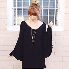 The latest and greatest! @seedanistyle in our @audrey3plus1 Black Bell Sleeve Dress!