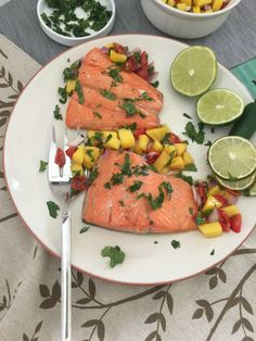 Orange lime salmon with mango salsa. The sweet, fruity flavors pair nicely with the salmon and make it a family favorite and a great dish for lent.