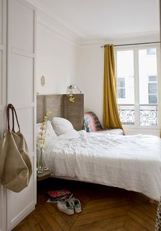 a Paris inspired chic bedroom with a shutter screen as a headboard, a herringbone floor, mustard curtains and a comfy chair Laura Lee, Closet Bedroom, Home Bedroom, Bedrooms, Parisian Bedroom Decor, Gold Bed, Yellow Curtains, Gravity Home, Comfy Bed