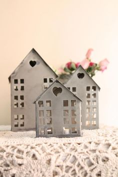 Houses...can make it with paper r cardboard...n light a tea light(battery operated)