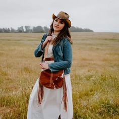 Ladies, take them by storm in this hat! Bringing a handcrafted pinch on the crown that gives you that carefree Double G Western appeal, the Women's Cyclone leather cowboy hat is available in a large variety of distinctive colors that will please any personality and match your mood no matter which way the wind blows. #hats #cowboyhats #cowgirlhats #ahm #americanhatmakers Leather Cowboy Hats, Cowgirl Hats, Leather Handbags, Leather Bag, Hipster, Bohemian, Lady, Personality, Crown