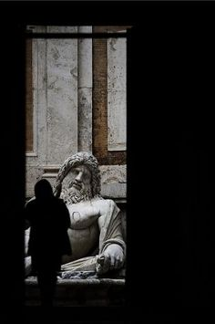 A view of a statue at the entrance of the Capitolini museums on Piazza del Campidoglio in central Rome