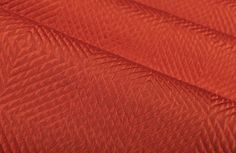 Impulse Geometric Upholstery Fabric in Brick has a rust hued diamond pattern with a slight sheen that gives a metallic look. Ideal for upholstering sofas, chairs, and ottomans or for creating custom bedding and pillows. Red Interior Design, Custom Bedding, Upholstered Sofa, Red Interiors, Diamond Pattern, Ottomans, Hue, Sofas, Brick