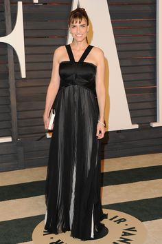 Actress Amanda Peet wearing a J. Mendel Black Silk Mousseline and Satin Faced Chiffon Pleated gown to the Vanity Fair Oscar Party held on Sunday, February 22nd, 2015, in Los Angeles, California. | www.jmendel.com