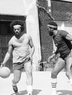 Singer Marvin Gaye and politician and civic servant Rev. Jesse Jackson play one-on-one basketball. 1976