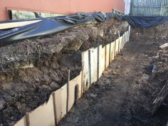 Rain caused collapse of clean cut wall which was reconstructed by hand