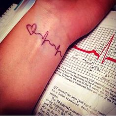 baby's first heartbeat as a tattoo