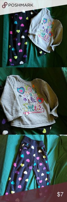 "Girls 24 months Outfit sweatshirt w/fleece pants Girls 24 months Outfit sweatshirt w/fleece pants. Pants are black with rainbow colors heart pattern. Shirt is gray with hearts and screenprinting ""You make me Smile"". Only washed with fragrance free detergent.  Check out my other kids clothes for a bundle savings of 20%! Garanimals  Matching Sets"