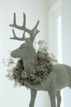 Wreath around deer's neck