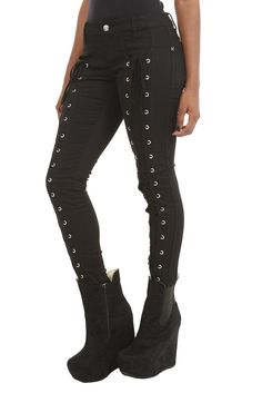 black skinny pants with lace-up accents along the front of each leg