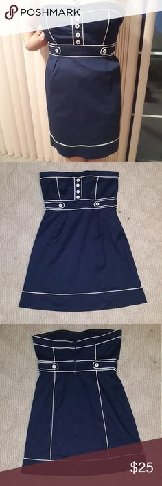 """Navy blue nautical BLANCO brand dress from Spain Super cute navy blue strapless dress with button detailing (spare button included), 97% cotton, by BLANCO brand (Spain), unique and unavailable anywhere else. Size M (runs small). Length 25"""". Dress on model, front, back, and side views photographed.  Worn twice. Blanco Dresses Strapless"""