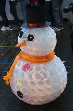 Frosty the snowman art from plastic cups Or make them into snowballs to hang in the trees and light them up.